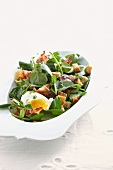 Watercress salad with ham, croutons and egg