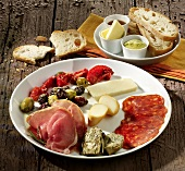 A plate of Mediterranean cheeses and cold meats