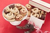 Assorted Christmas biscuits on plate and in box