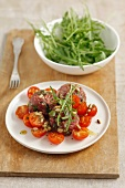 Beef tartar with tomatoes, rocket and basil