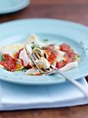 Fish ravioli with tomato sauce