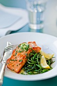 Salmon fillet with herb butter, glasswort and lemons
