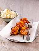 Grilled shrimp and pineapple kebabs with curry powder and curry ice cream