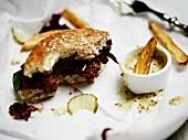Remains of a hamburger and fries