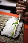 Maki sushi being prepared