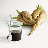 A Jar of Sugar Beet Syrup with Fresh Sugar Beets