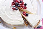 Cheesecake with berries, one slice cut (view from above)
