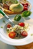 Kohlrabi spaghetti with tomatoes and basil