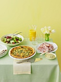 A spring meal of spinach quiche, ham and salad