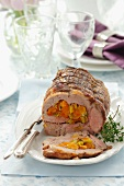 Rolled pork joint stuffed with dried apricots and leek