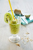 Pineapple and kiwi shake with slivered almonds