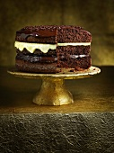 Three-layer chocolate cake on a cake stand