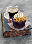 A florentine cupcake with a cup of coffee