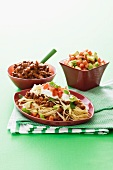 Spaghetti with minced meat, kidney beans, avocado, tomatoes and sour cream