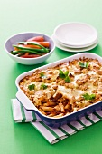 Pasta bake with dried tomatoes, cheese and croutons