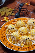Halloween spiders made of cream cheese and savoury snacks