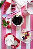 A breakfast of milkshake, berry muesli and fresh milk