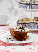 Caffe latte cupcakes, one on a plate and more on a cake stand
