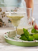 Kiwi and apricot smoothie with mint