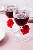 Glasses of red wine decorated with pompoms