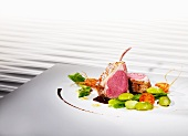 Rack of lamb cooked 'sous vide', on a bed of beans