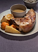 Veal chop with gravy and vegetables