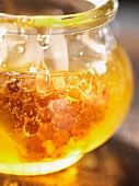Honey with honeycomb in a jar (close-up)