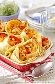 Pancakes filled with chicken, peppers and pineapple in garlic sauce