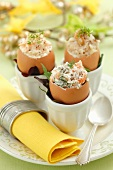 Assorted filled eggshells: with celery and walnuts, with carrots and horseradish, and with salmon