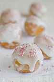 Doughnuts with sugar glaze and sugar sprinkles