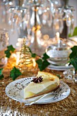 A slice of pear and ginger cheesecake with star anise
