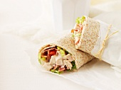 Wraps filled with chicken breast, bacon, tomatoes and lettuce
