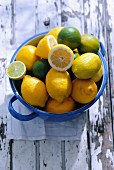 Fresh lemons and limes in a ceramic pot