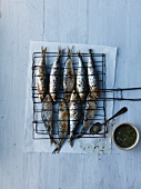 Barbecued sardines with a spicy sauce