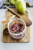 Pear and plum compote in a jar