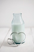 A milk bottle with heart-shaped cutters
