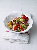Potato salad with cherry tomatoes and capers