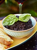 Tapenade with a sprig of basil