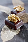 Filled chocolates topped with walnuts
