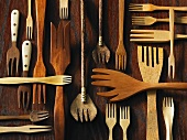 Assorted wooden forks on a wooden surface