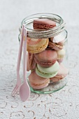 Assorted macaroons in a jar