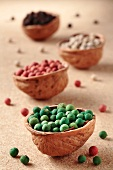 Colourful peppercorns in walnut shells