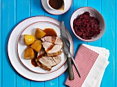 Roast pork with crackling, served with potatoes and red cabbage (Denmark)