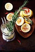 Squeezed Lemons with Rosemary and Red Chili Peppers