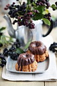 Mini Bundt cakes with rum berries and chocolate glaze