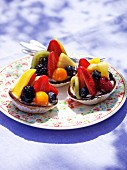 Three colourful fruit tartlets