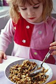 Young Girl having breakfast