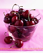 Cherries in a stemmed glass bowl