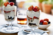Toasted oats, seeds, berries and Greek yoghurt, with maple syrup.