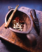 Spices in a wooden mortar with pestle